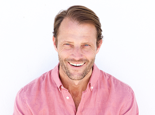 male-fashion-model-smiling-against-white-wall-ZFGJQD4.jpg
