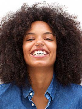 happy-friendly-woman-smiling-on-isolated-white-ZNM3GBU.jpg